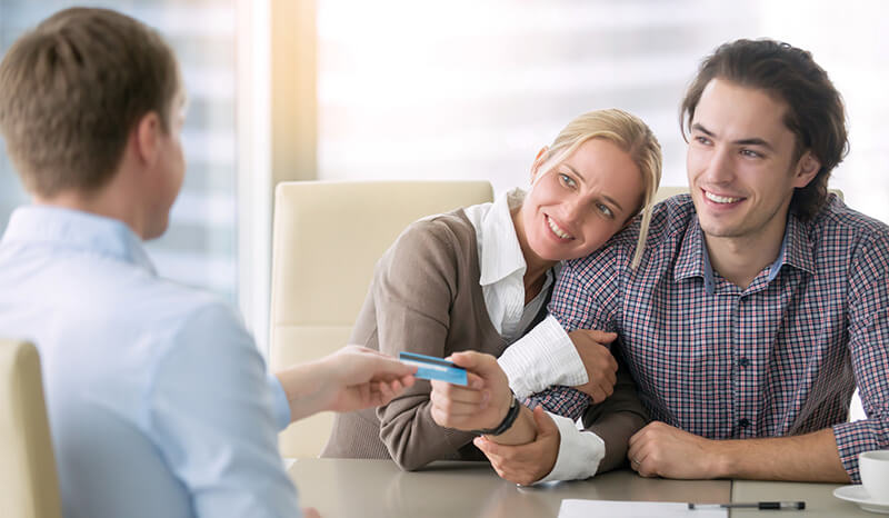 Young couple talking with financial professional, financial planning